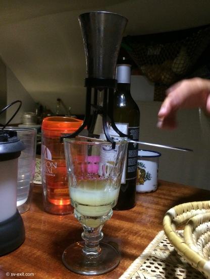 Demonstration of Tami aboard S/V Avighna cooking Absinthe