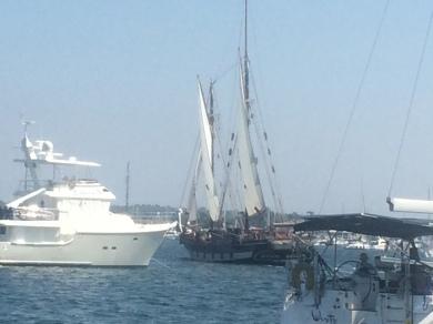 Mystic Whaler sails through the anchorage